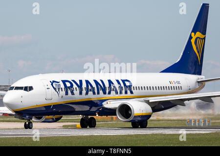 Ryanair Boeing 737-800, registration EI-EBZ, preparing for take off at Manchester Airport, England. - Stock Photo