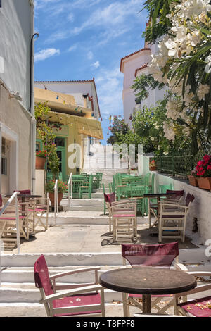 Cozy outdoor cafes in Chora town on Andros island, Cyclades - Stock Photo