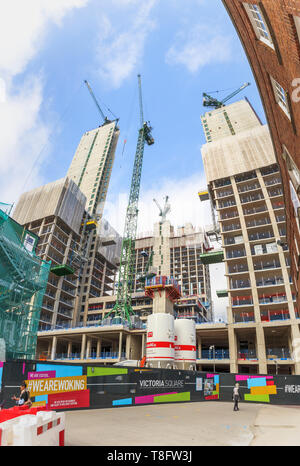 Woking, Surrey: construction of the new high rise mixed use Victoria Square development continues with concrete cores and tower cranes - Stock Photo