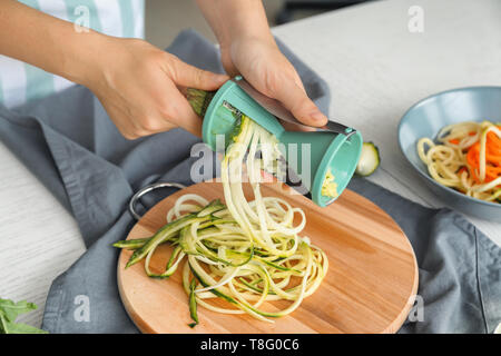 Woman making zucchini spaghetti - Stock Photo