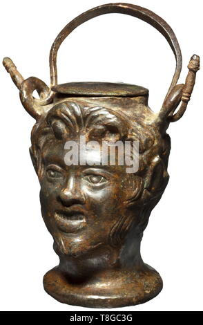 A Roman ointment vessel shaped like a Satyr's head, 2nd century A.D. Bronze with greenish patina. Vessel shaped like the three-dimensional head of a young Satyr with chin beard, pointed ears and curly hair. Two loops on the side with intact carrying handle, hinged, round lid. Height without handle 9 cm. Provenance: Private collection in the USA, ex Christie's, New York, 12 December 2002. Before that part of an English private collection since 1978. historic, historical, Roman Empire, ancient world, ancient times, ancient world, Additional-Rights-Clearance-Info-Not-Available - Stock Photo