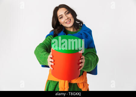Image of attractive woman 30s with dark hair in colorful clothes holding big gift box while standing isolated over white background - Stock Photo