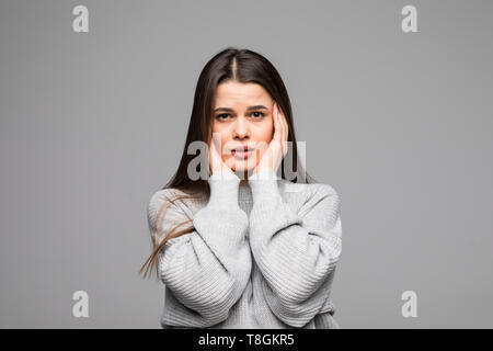 Beautiful middle age woman wearing winter sweater over isolated background with hand on head for pain in head because stress. Suffering migraine. - Stock Photo