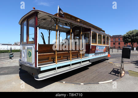 Editorial Image: San Francisco ,California USA -04/22/2019- One of the famous cable cars sits on the turntable at the end of the Powell- Hyde line. - Stock Photo