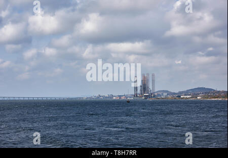 The Oil and Gas Port of Dundee with 2 Jackup Rigs alongside the Prince Charles Wharf for maintenance, on the Tay Estuary. Dundee, Scotland. - Stock Photo