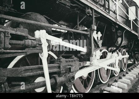 Retro steam locomotive wheels and rods. Details of mechanical parts. - Stock Photo
