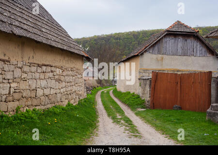 Old stone houses by the typical Ukrainian village street. Authentic Ukrainian countryside. - Stock Photo