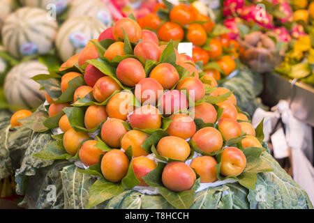 Bunch of fresh apricots for sale in market - Stock Photo