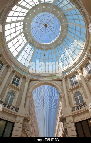 THE HAGUE, NETHERLANDS - APRIL 19, 2019: De Passage, an indoor shopping arcade (built between 1882 and 1885), with a view on a high glass ceiling - Stock Photo
