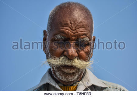 An old man with a long mustache. - Stock Photo