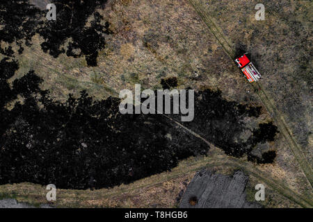 fire truck on fire aerial view - Stock Photo