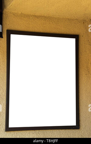 Blank white sign in brown frame on golden yellow wall - Stock Photo