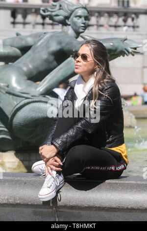London, UK. 13th May 2019.A woman   enjoys the warm sunshine in Trafalgar Square London Credit: amer ghazzal/Alamy Live News - Stock Photo
