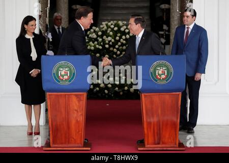 Panama's President Juan Carlos Varela (L) shakes hands with the elect President Laurentino Cortizo (R) after a meeting of command handover at the Presidential Palace, in Panama City, Panama, on 13 May 2019. EFE/Bienvenido Velasco - Stock Photo