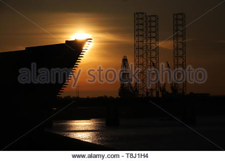 Dundee, UK. 14th May, 2019. The dramatic silhouette of the V&A Design Museum at sunrise in Dundee, a bright start to a warm sunny day in Tayside. Credit: Stephen Finn/Alamy Live News - Stock Photo