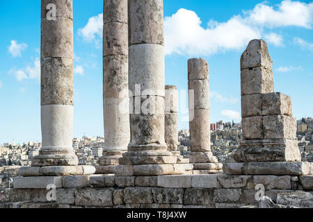 Cityscape view through the columns of Hercules Temple, Amman Citadel, Amman, Jordan Stock Photo