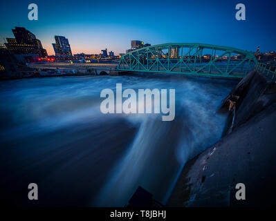 Water breaching Ottawa river in spring flood. - Stock Photo