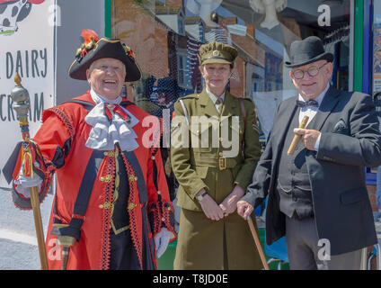 World War 2 reenactors with town cryer - Stock Photo