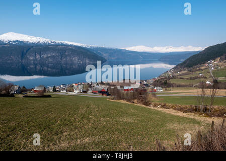 Idyllic Utvik in Sogn og Fjordane county, Nordfjord, Norway is a small farming community on the southern shore of the Nordfjord not far from Olden. - Stock Photo