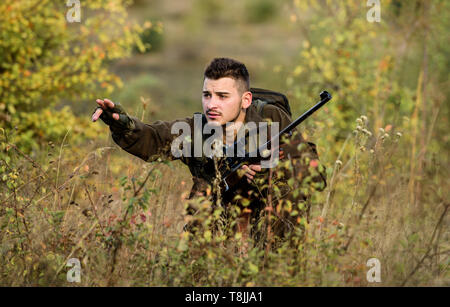 Hunting is brutal masculine hobby. Hunting and trapping seasons. Bearded serious hunter spend leisure hunting. Man wear camouflage clothes nature background. Hunting permit. Hunter hold rifle. - Stock Photo
