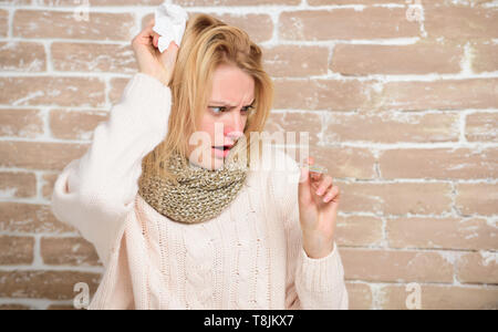 Running fever. Becoming unwell with cold or flu. Cute ill girl measuring body temperature. Sick woman holding fever thermometer. Unhealthy pretty woman suffering from fever heat. - Stock Photo
