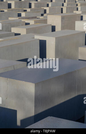 Abstract view of tens of concrete slabs or stelae at the Memorial to the Murdered Jews of Europe, also known as Holocaust Memorial, in Berlin, Germany - Stock Photo