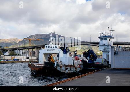 Old car ferries Selbjorn (ex Ropeid) and Stolmasund at repair yard in Damsgaardssundet, Bergen port, Norway. Puddefjordsbroen bridge in background. - Stock Photo