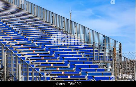 Empty tribunes in preparation for Formula 1 Monaco Grand Prix in the Monte Carlo Yacht Club marina harbor - Stock Photo