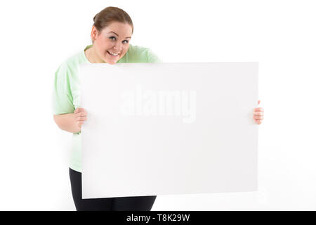 Cute chubby woman holding a white billboard, isolated on white - Stock Photo