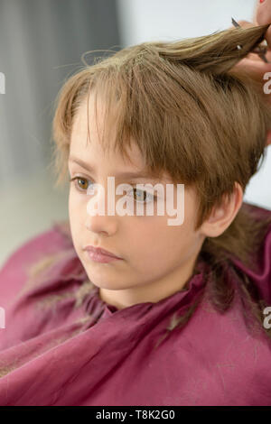 Cute serious little boy at barbershop - Stock Photo