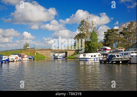 A view of a Broads cruiser passing under Ludham Bridge on the River Ant at Ludham, Norfolk, England, United Kingdom, Europe. - Stock Photo
