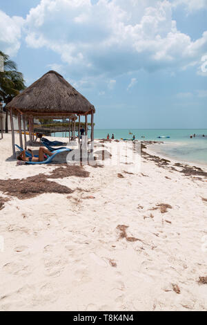Mexican beach - tourists on the beach on the Gulf of Mexico at Campeche, Yucatan, Mexico Central America - Stock Photo
