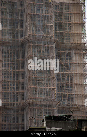 Bamboo scaffolding has been used in Hong Kong since the 1800s and can still be seen in the city today - Stock Photo