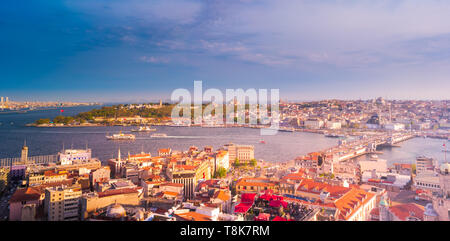 Galata Bridge on the Golden Horn, with mosques in the background, as seen from the Galata Tower. Beautiful sunset in Turkey, Istanbul. - Stock Photo