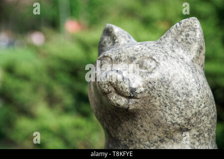 Cat statue from stone. Lucky rock cat head. - Stock Photo