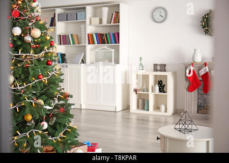 Decorated Christmas tree in living room - Stock Photo