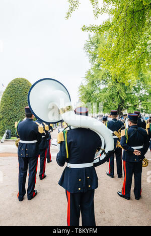 STRASBOURG, FRANCE - MAY 8, 2017: Ceremony to mark Western allies World War Two victory Armistice in Europe marking the 72nd anniversary of victory - playing big brass tuba  - Stock Photo
