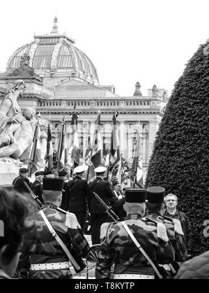 STRASBOURG, FRANCE - MAY 8, 2017: Black and white image soldiers parade victory Armistice in Europe marking the 72nd anniversary of victory with Monument aux morts de Strasbourg - Stock Photo
