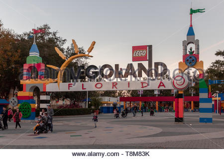 Winter Haven, Florida USA - January 22, 2019: Legoland sign in the main entrance to Legoland with some people in the enter on the Sunset - Stock Photo