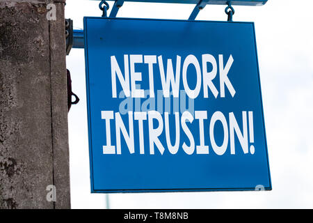 Writing note showing Network Intrusion. Business concept for device or software application that monitors a network - Stock Photo
