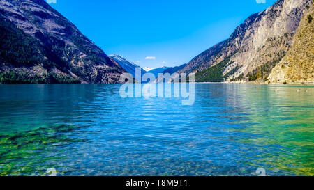 Green waters of Seton Lake on the foot of Mount McLean near Lillooet. Seton Lake is located along Highway 99, or the Duffey Lake Road, in BC Canada - Stock Photo