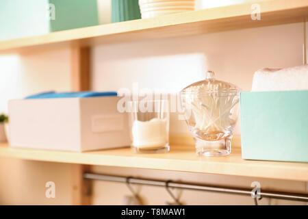 Body care accessories on shelf in bathroom - Stock Photo