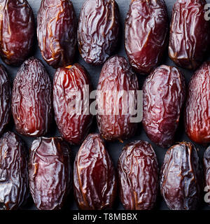 Fresh Medjool Dates background. Healthy organic product. Top view. - Stock Photo