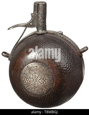 A powder flask from the Electoral Saxon Trabanten Guard, circa 1590 Semispherical fruitwood body, nubby on the front side, with ornamentally etched, inlaid silver plate. The iron mounting with spring-loaded spout florally etched in the typical Saxon style. On the reverse side an old carved monogram 'AME'(?). Diameter 8 cm. historic, historical, handgun, firearm, fire arm, firearms, fire arms, gun, guns, hand weapon, hand weapons, object, objects, stills, 16th century, Additional-Rights-Clearance-Info-Not-Available - Stock Photo