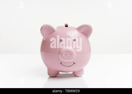 piggy or coin bank or piggybank or money box - finance and savings concept on white background with reflection - Stock Photo