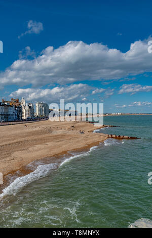 The sea front at Eastbourne showing the pebbled beach. Photo taken from Eastbourne Pier. Completed in 1872. - Stock Photo