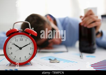 Businessman in blue shirt asleep at work - Stock Photo