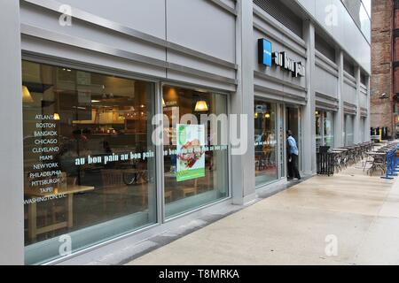 CHICAGO, USA - JUNE 26, 2013: Person enters Au Bon Pain sandwich store in Chicago. Au Bon Pain is a fast-casual bakery and cafe company with 240 store - Stock Photo