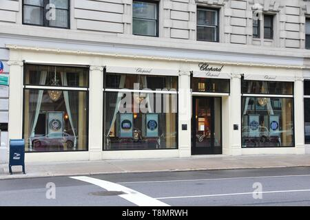 NEW YORK, USA - JULY 1, 2013: Chopard watch store in Madison Avenue, NY. Madison Avenue is one of the most recognized fashion shopping destination in  - Stock Photo