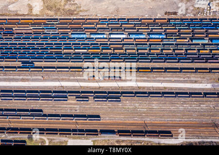 Cargo trains. Aerial view of colorful freight trains on the railway station. Wagons with goods on railroad.Aerial view - Stock Photo